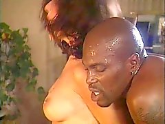 Big black stud gets his cock sucked by two hot white chicks
